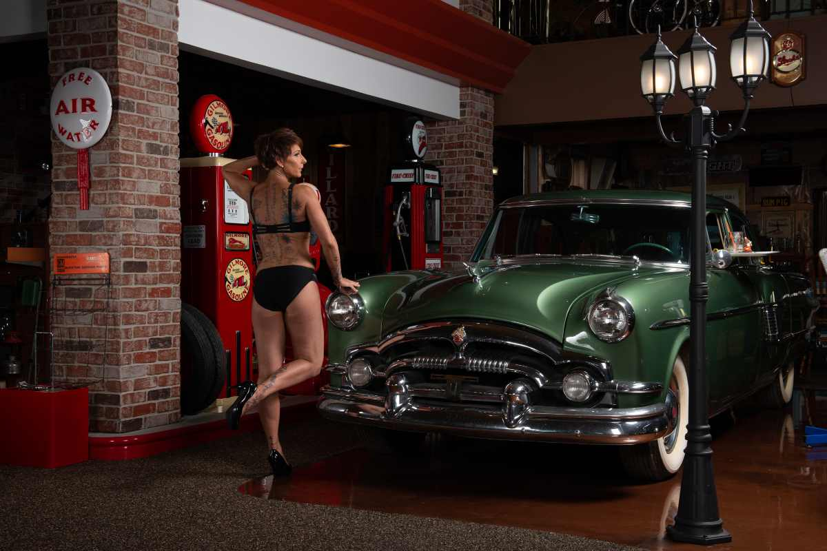 Colette in front of a classic car